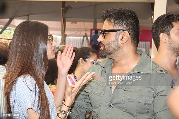 Bollywood actor Suniel Shetty with daughter and actor Athiya Shetty at wife Mana Shetty's designer store anniversary celebrations at Araaish...