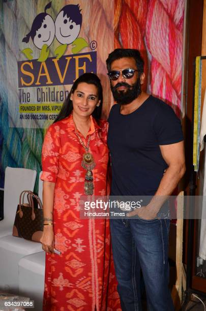Bollywood actor Suniel Shetty with her wife Mana Shetty during a Charity exhibition Araaish organised by Mana Shetty wife of actor Suniel Shetty at...