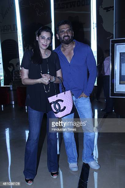 Bollywood actor Suniel Shetty with his wife Mana Shetty during the trailer launch of movie Hero at PVR Juhu on July 15 2015 in Mumbai India Hero is...