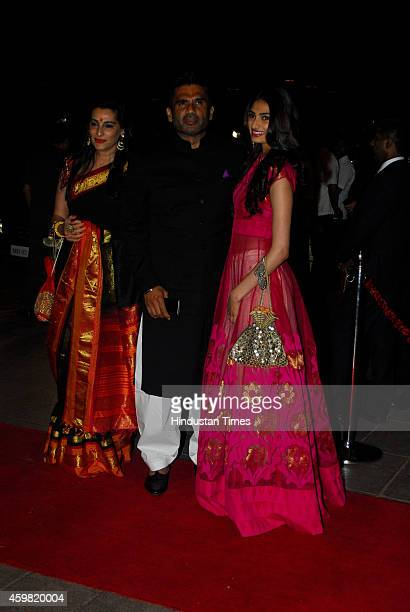 Bollywood actor Suniel Shetty with wife Mana Shetty and daughter Athiya Shetty arrive for the wedding reception of Salman Khans sister Arpita Khan at...