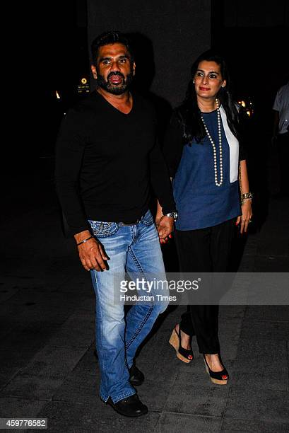 Bollywood actor Suniel Shetty with wife Mana Shetty arrive for felicitation ceremony of cricketer Rohit Sharma who hit a worldrecord double century...