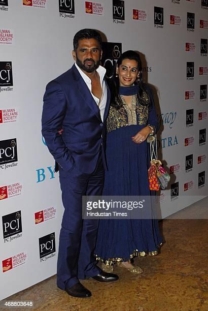 Bollywood actor Suniel Shetty with wife Mana Shetty during fund raising fashion show oraganized by NGO Mijwan At Grand Hyatt Kalina on April 4 2015...