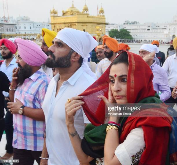 Bollywood actor Suniel Shetty with wife Mana Shetty on his birthday paying obeisance at Golden Temple on August 11 2017 in Amritsar India