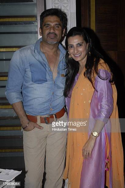 Bollywood actor Sunil Shetty along with his wife fashion designer Mana Shetty during Trousseau Araaish a fund raising showcase to Save The Children...