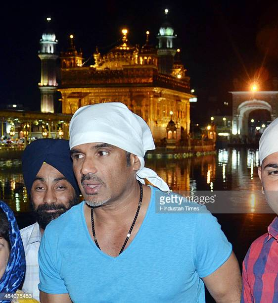 Bollywood actor Sunil Shetty paying obeisance at Golden Temple on Apriil 11 2014 in Chandigarh India