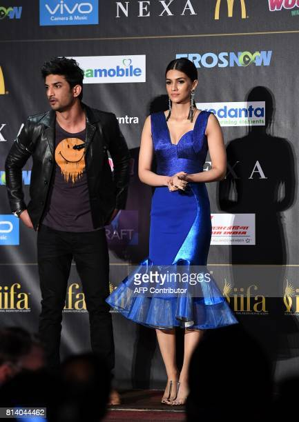 Bollywood actor Sushant Singh Rajput and actress Kriti Sanon pose during a press conference ahead of the 18th International Indian Film Academy...