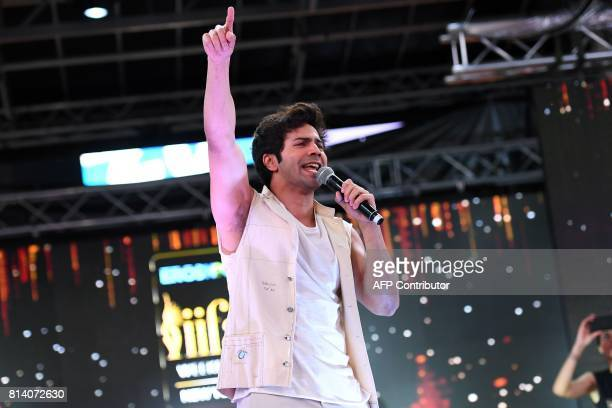 Bollywood actor Varun Dhawan performs during IIFA Stomp in the Times Square on July 13 2017 to kick off the 18th International Indian Film Academy...