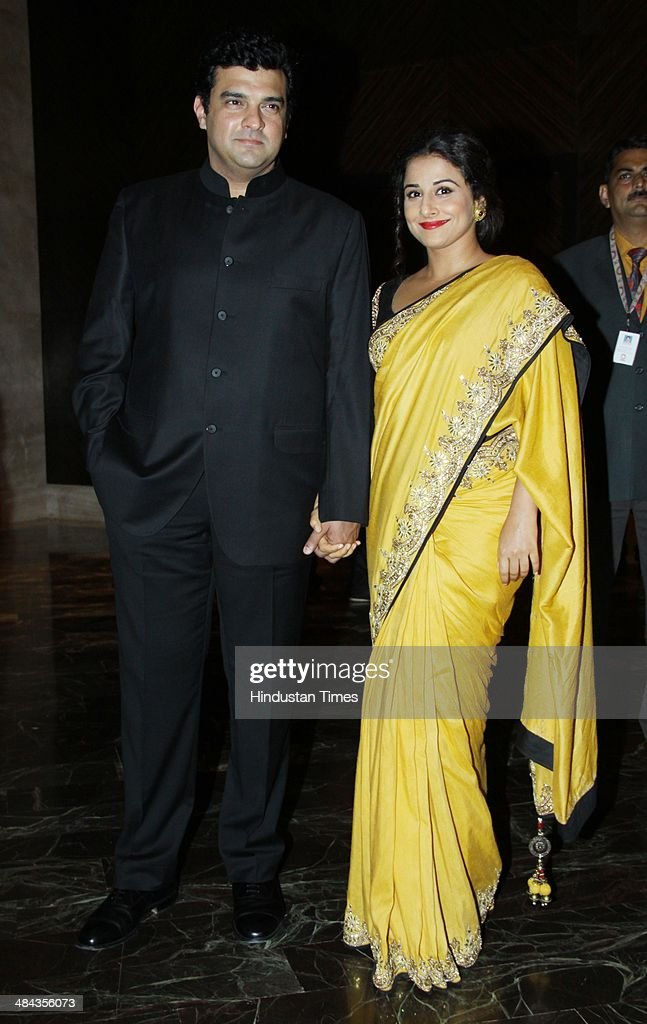 Bollywood actor Vidya Balan with her husband and filmmaker <a gi-track='captionPersonalityLinkClicked' href=/galleries/search?phrase=Siddharth+Roy+Kapur&family=editorial&specificpeople=6236847 ng-click='$event.stopPropagation()'>Siddharth Roy Kapur</a> during the fundraiser in support of Swades Foundation, at Palladium Hotel, Lower Parel on April 10, 2014 in Mumbai, India. Founded by Ronnie and Zarina Screwvala, the Swades Foundation operates with the single-minded focus of empowering Rural India. Their goal is to empower one million people in rural India every five years and lift them out of poverty permanently, creating rural communities that are a strong asset to 21st century India.