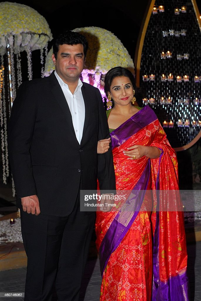 Bollywood actor Vidya Balan with her husband and <a gi-track='captionPersonalityLinkClicked' href=/galleries/search?phrase=Siddharth+Roy+Kapur&family=editorial&specificpeople=6236847 ng-click='$event.stopPropagation()'>Siddharth Roy Kapur</a>, MD, Disney India during wedding ceremony of Riddhi Malhotra and Tejas Talwalkar on December 15, 2014 in Mumbai, India. Riddhi Malhotra is sister of director Punit Malhotra and niece of designer Manish Malhotra.