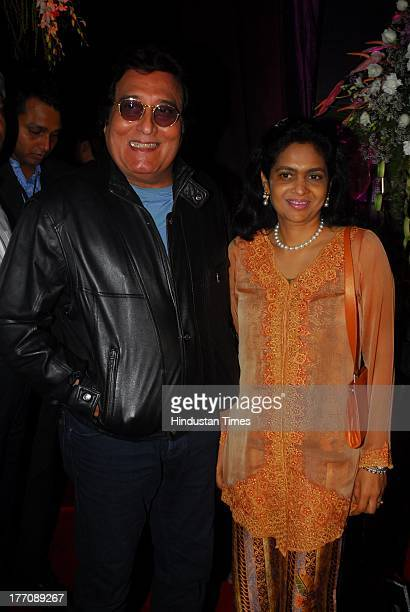 Bollywood actor Vinod Khanna with wife Kavita during the celebration of Sridevi's 50th birthday at Alibi Colaba on August 17 2013 in Mumbai India...