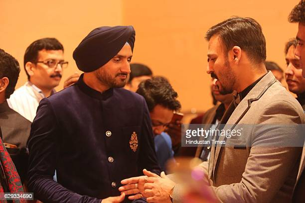 Bollywood actor Vivek Oberoi and cricketer Harbhajan Singh at the wedding reception of Union Minister Nitin Gadkari's daughter Ketki and Aditya...