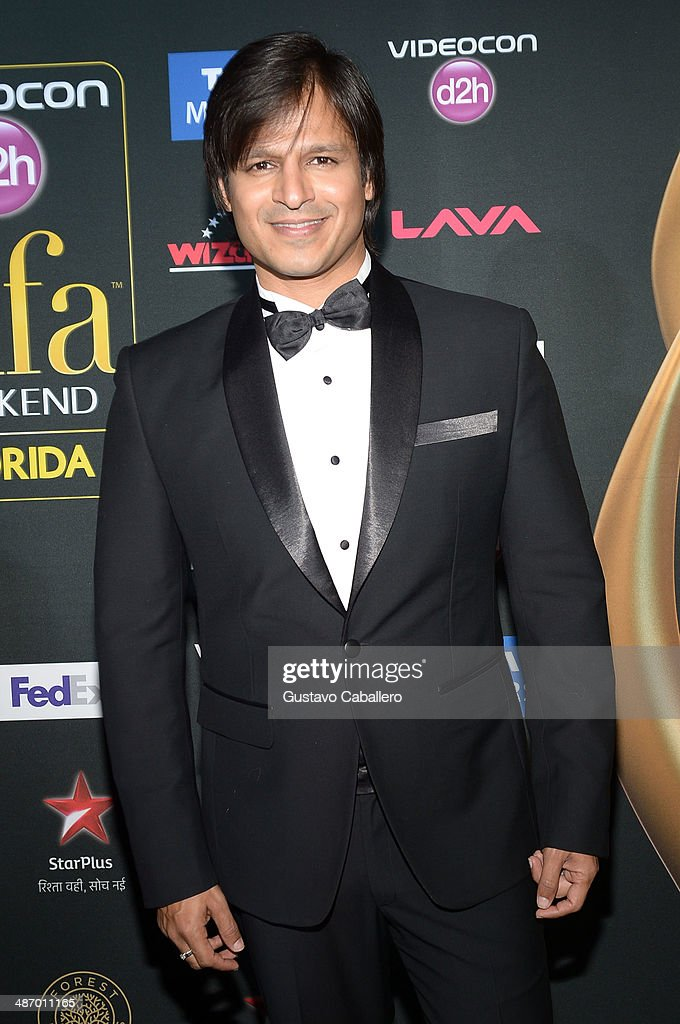 Bollywood actor <a gi-track='captionPersonalityLinkClicked' href=/galleries/search?phrase=Vivek+Oberoi&family=editorial&specificpeople=627274 ng-click='$event.stopPropagation()'>Vivek Oberoi</a> is interviewed on the green carpet at the IIFA Awards at Raymond James Stadium on April 26, 2014 in Tampa, Florida.