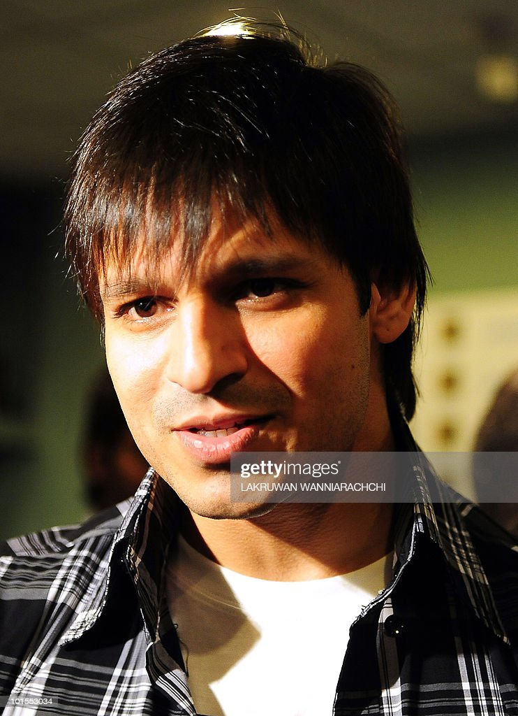 Bollywood actor Vivek Oberoi smiles during a news conference for the International Indian Film Academy (IIFA) foundation celebrity cricket match in Colombo on June 2, 2010. Bollywood goes to Sri Lanka later this week for its glitzy annual awards ceremony, but the decision to hold the event in the capital Colombo has sparked a backlash from minority Tamils in India. AFP PHOTO/ Lakruwan WANNIARACHCHI.