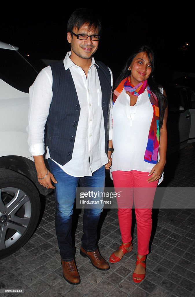 Bollywood actor Vivek Oberoi with his wife Priyanka attending special screening hosted by Ritesh Deshmukh for his first home production Marathi film 'Balak Palak' at PVR Juhu on January 2, 2012 in Mumbai, India.