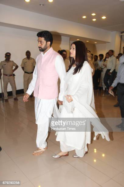 Bollywood actors Abhishek and Aishwarya Rai Bachchan during the prayer meeting organised for the late Bollywood veteran Vinod Khanna at Worli on May...