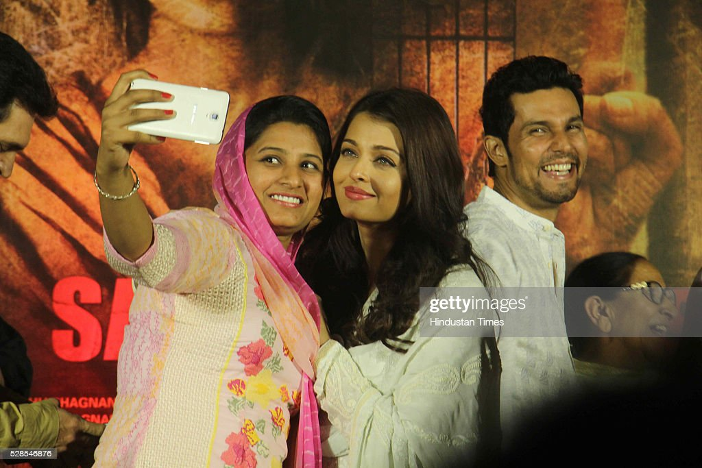 Bollywood actors Aishwarya Rai Bachchan, Randeep Hooda with Sarabjit Singh's sister Dalbir Kaur and daughter Poonam Kaur during the 3rd death anniversary of Sarabjit Singh - a farmer from Punjab who was convicted of terrorism and spying by a Pakistani court, at ISKCON, Juhu, on May 4, 2016 in Mumbai, India. The function started with the recitation of some hymns from the Guru Granth Sahib, followed by the introduction of Sarabjit's family by the film's cast. The film will be narrated through the perspective of Sarabjit Singh's sister Dalbir Kaur played by Aishwarya Rai. The movie is schedule to release on May 20, 2016.