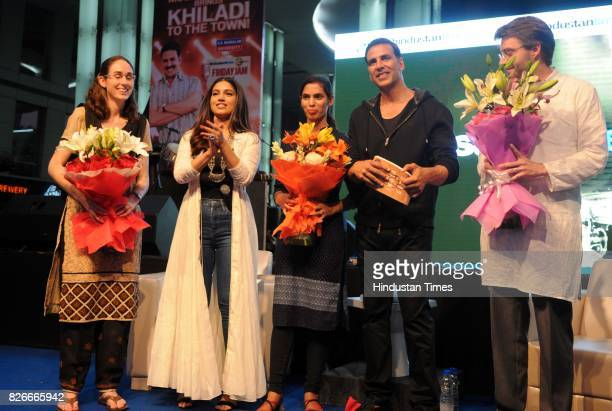 Bollywood actors Akshay Kumar and Bhumi Pednekar with youngest sarpanch of India Jabna Chauhan and author Diane Cossey and Dean Cossey during the 4th...
