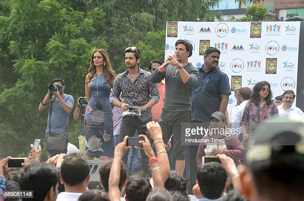 Bollywood actors Akshay Kumar Ileana D'Cruz Arjan Bajwa and Esha Gupta interacting with fans while promoting their upcoming movie Rustom at Hansraj...