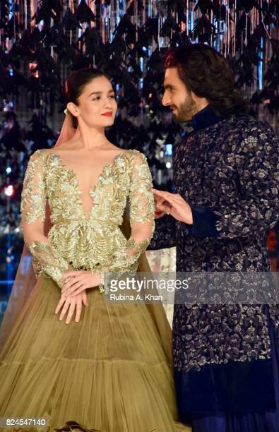 Bollywood actors Alia Bhatt and Ranveer Singh walk for Manish Malhotra during FDCI's India Couture Week 2017 at the Taj Palace hotel on July 30 2017...