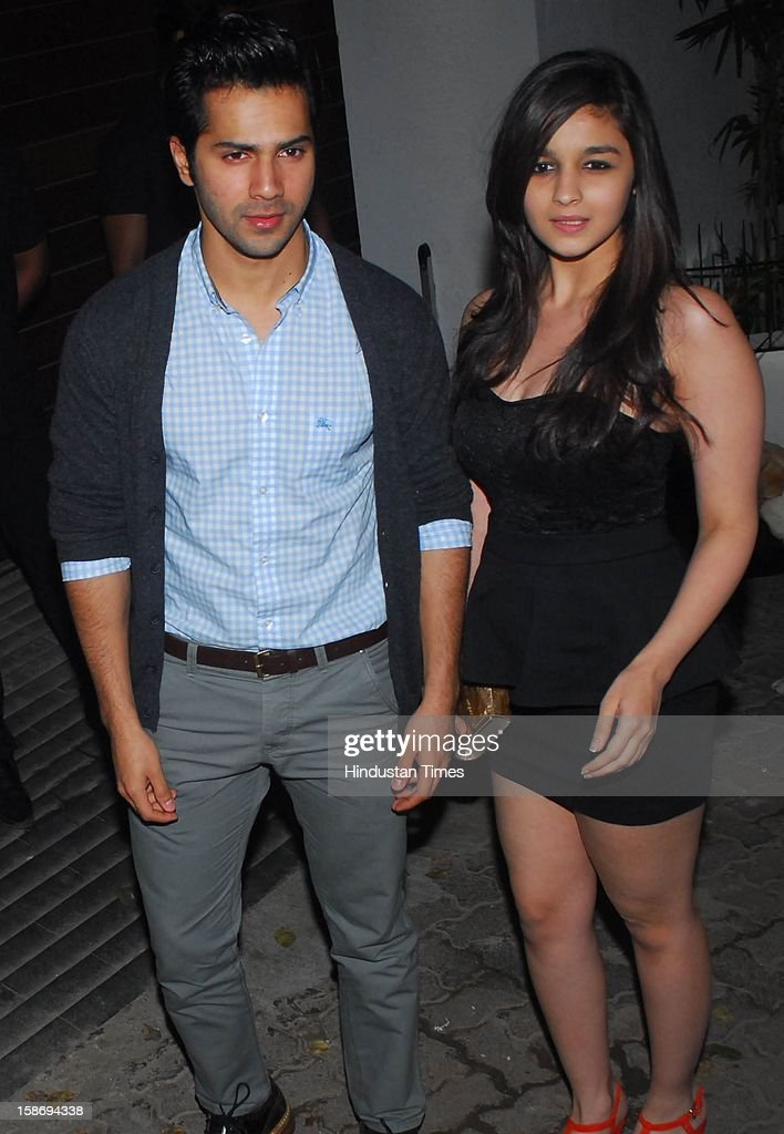 Bollywood actors Alia Bhatt and <a gi-track='captionPersonalityLinkClicked' href=/galleries/search?phrase=Varun+Dhawan&family=editorial&specificpeople=9620705 ng-click='$event.stopPropagation()'>Varun Dhawan</a> during Imran Khan's house warming party on December 22, 2012 in Mumbai, India.
