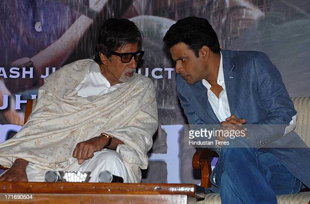 Bollywood actors Amitabh Bachchan and Manoj Bajpai during the theatrical trailer release of film Satyagraha at Taj Lands End Bandra on June 26 2013...