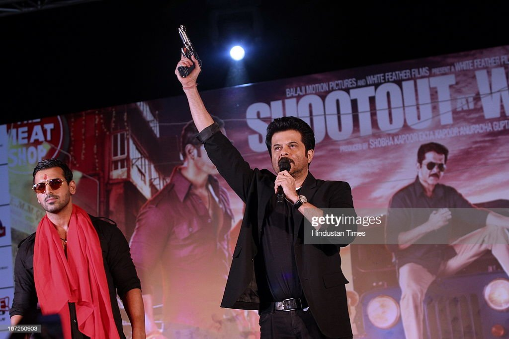 Bollywood actors Anil Kapoor with John Abraham performing during the promotion of their upcoming film 'Shootout At Wadala' at The Great India Place, shopping mall on April 21, 2013 in Noida, India. It is the sequel to 2007 film Shootout at Lokhandwala, and is based on the book Dongri to Dubai written by Hussain Zaidi. The film features John Abraham, Anil Kapoor, Kangna Ranaut, Tusshar Kapoor and Sonu Sood in lead roles. The film was expected to release on May 1, 2013, but has been postponed to release on May 3, 2013.