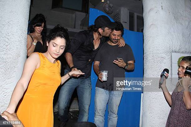 Bollywood actors Ankita Lokhande and Sushant Singh Rajput with producer Vikas Bahl at the party hosted by Deepika padukone for the success of film...