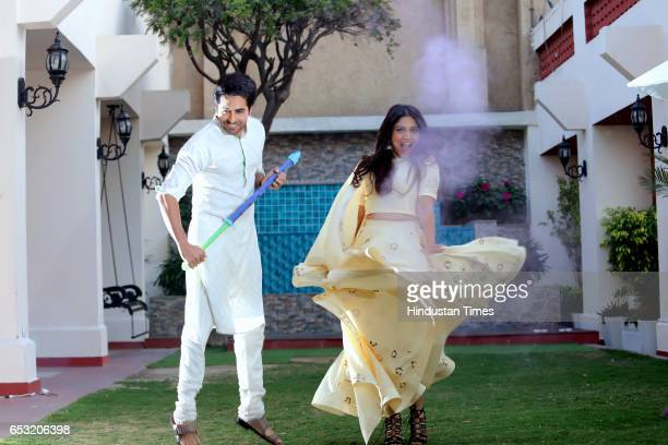 Bollywood actors Ayushmann Khurrana and Bhumi Pednekar playing Holi for the photo shoot at Eros Hotel Nehru Place on March 7 2017 in New Delhi India