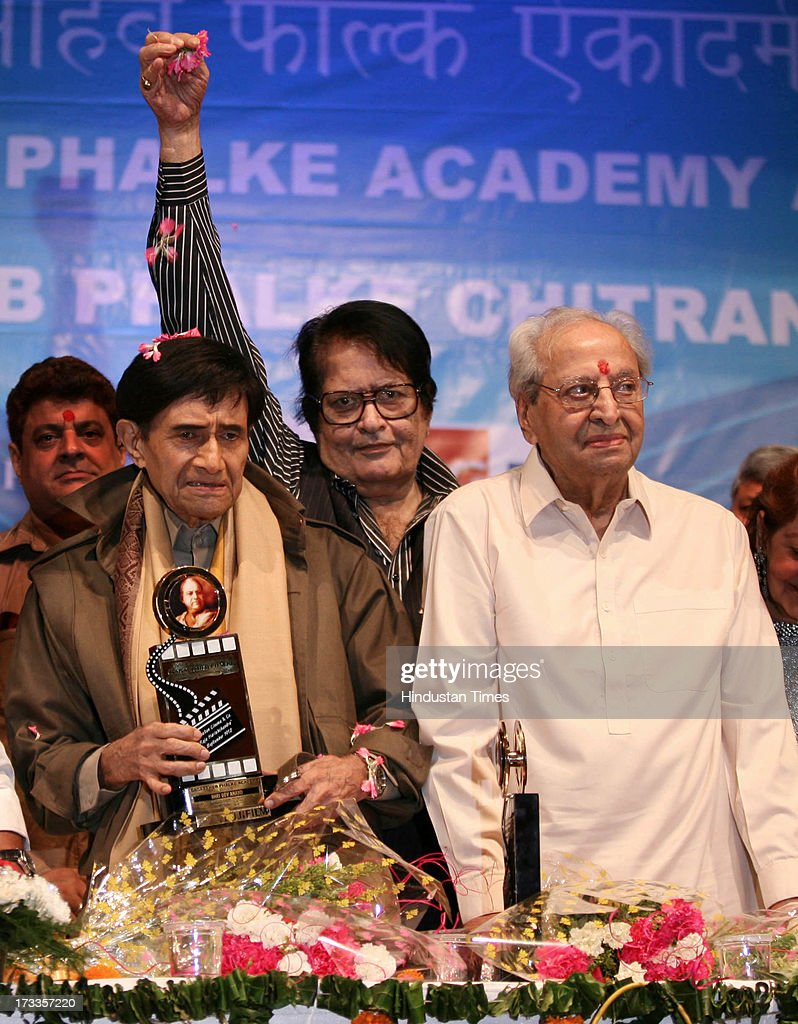 Bollywood actors Dev Anand, Manoj Kumar and Pran at the felicitation of Dev Anand on Dadasaheb Phalke Awards Ceremony at Bhaidas Hall, Vile Parle on April 30, 2010 in Mumbai, India. Veteran Bollywood actor Pran, who made a mark for himself portraying strong negative and supporting roles, passed away at the age of 93 on Friday evening after prolonged illness. Born on February 12, 1920, Pran has been known for remarkable roles in Bollywood hits like Zanjeer, Don, Amar Akbar Anthony, Upkaar, Parichay and Sharaabi among hundreds others.