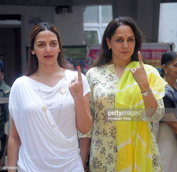 Bollywood actors Hema Malini and Esha Deol showing inked finger after casting votes for Maharashtra Assembly Elections 2014 polls at St Annes School...
