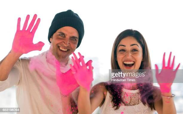 Bollywood actors Hrithik Roshan and Yami Gautam playing Holi for the photo shoot at JW Marriott Juhu on March 7 2017 in Mumbai India