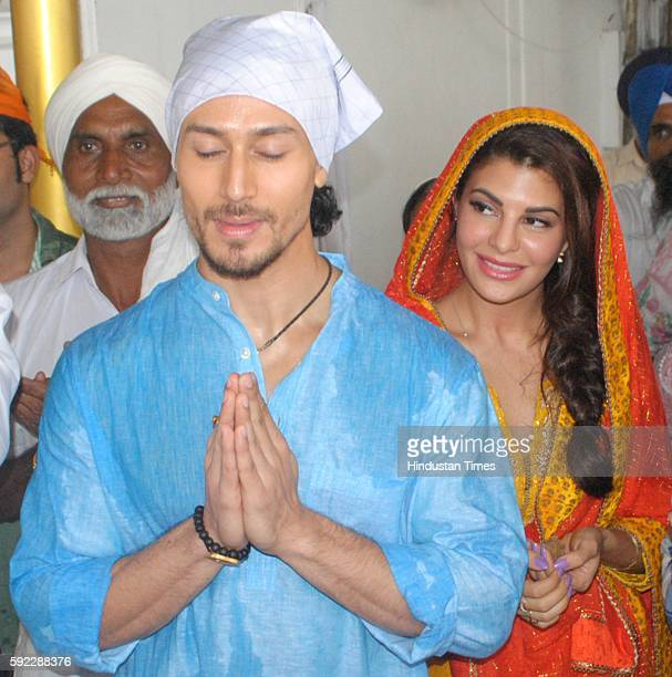 Bollywood actors Jacqueline Fernandez Tiger Shroff and professional wrestler Nathan Jones paying obeisance at Golden Temple for the promotion of...