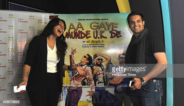 Bollywood actors Jimmy shergill and Neeru Bajwa promoting their upcoming movie 'Aa Gaye Munde UK De' on August 2 2014 in Noida India The movie is...
