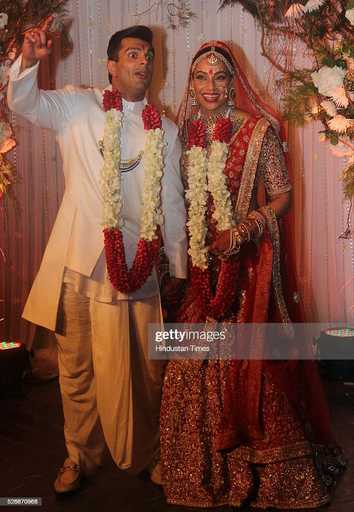 Bollywood actors Karan Singh Grover and Bipasha Basu pose during their wedding reception party at St. Regis Hotel on April 30, 2016 in Mumbai, India.