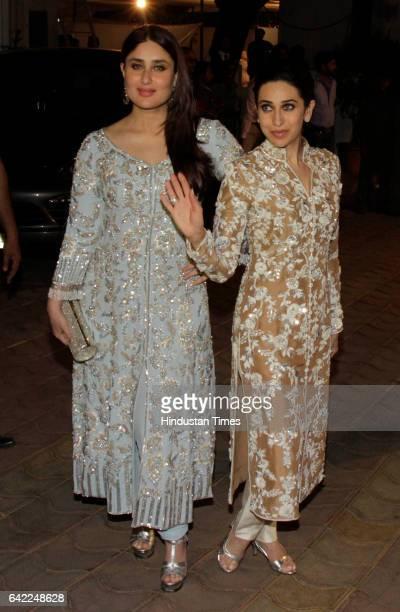 Bollywood actors Kareena Kapoor and Karisma Kapoor during the 70th birthday celebration of veteran actor Randhir Kapoor at his bungalow Chembur on...