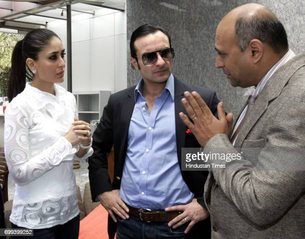 Bollywood actors Kareena Kapoor and Saif Ali Khan in serious discussion at the IPL bidding at Four Season's Hotel in Worli on Sunday