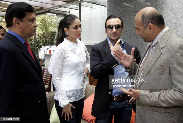Bollywood actors Kareena Kapoor and Saif Ali Khan in serious discussion with Venugopal Dhoot Vidiocon Owner at the IPL bidding at Four Season's Hotel...