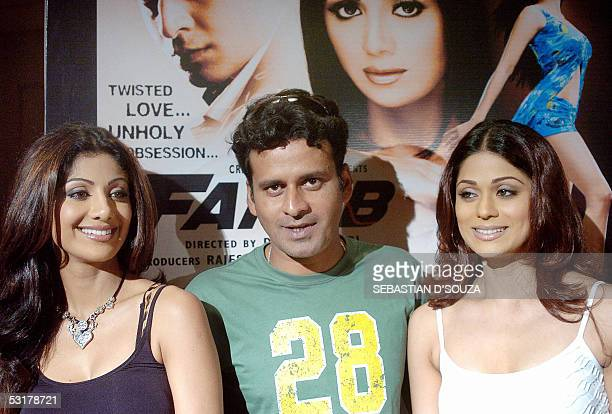 Bollywood actors Manoj Bajpai Shilpa Shetty and her sister Shamita are pictured at the launch of a range of wallpapers featuring her forthcoming...