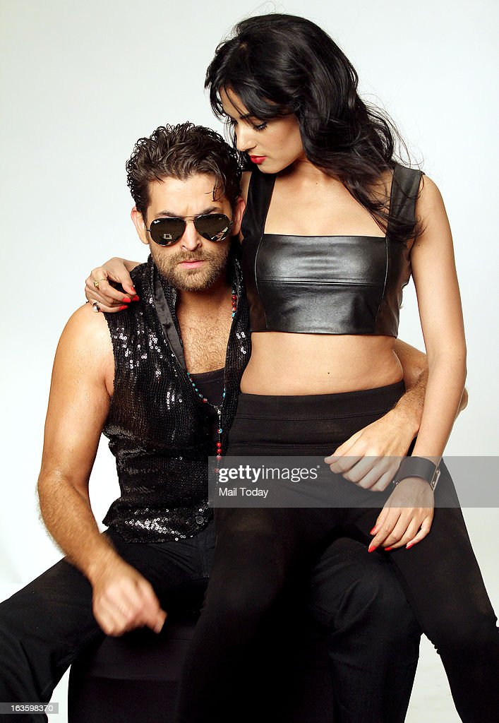 Bollywood actors Neil Nitin Mukesh and Sonal Chauhan pose during the photo soot of the film 3G, in Mumbai on Tuesday.