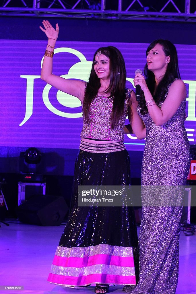 Bollywood actors Prachi Desai (L) with Roshni Chopra during the 3rd Anniversary celebration of Josh Mobile and launch of new mobile at Crowne Plaza, Rohini on June 13, 2013 in New Delhi, India.