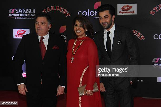 Bollywood actors Rishi Kapoor along with his wife Neetu Singh and son Ranbir Kapoor poses on red carpet for shutterbugs during the Sansui Colors...
