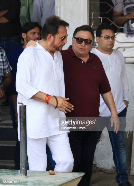 Bollywood actors Rishi Kapoor and Kiran Kumar arrive to attend the funeral of Bollywood actor Reema Laagu at Oshiwara crematorium on May 18 2017 in...