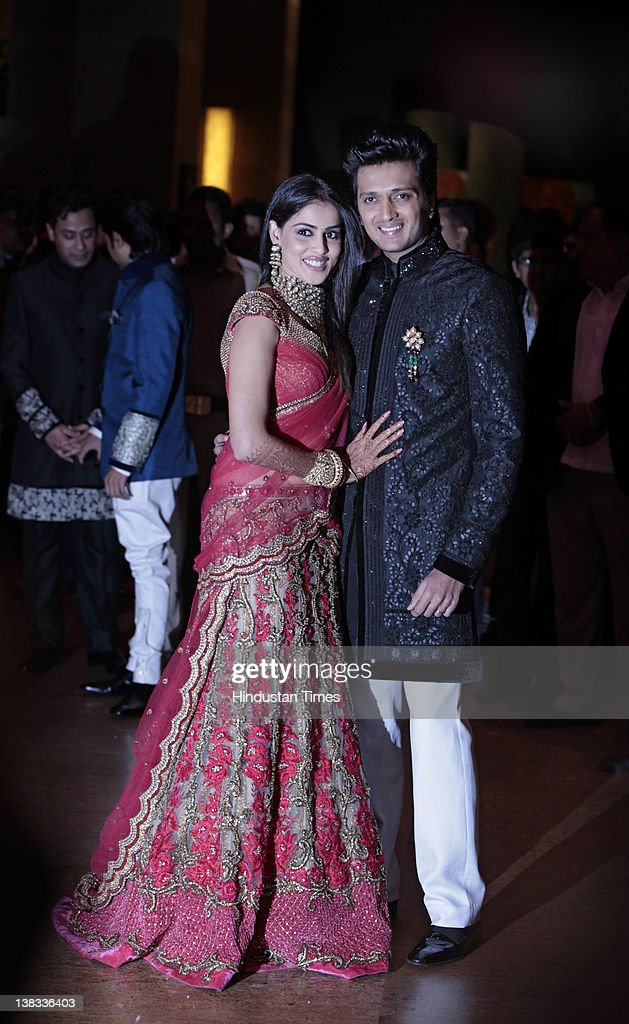 Bollywood actors <a gi-track='captionPersonalityLinkClicked' href=/galleries/search?phrase=Ritesh+Deshmukh&family=editorial&specificpeople=4141905 ng-click='$event.stopPropagation()'>Ritesh Deshmukh</a> and Genelia Deshmukh f.k.a. Genelia D'souza appear at their wedding reception at Grand Hyatt, Santacruz on February 4, 2012 in Mumbai, India. The reception was followed by lavish Maharashtra wedding on February 3 and a traditional Church wedding on February 4.