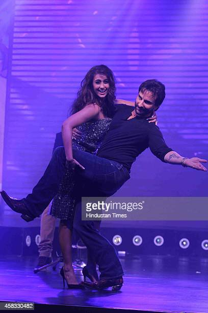 Bollywood actors Saif Ali Khan and Ileana D'Cruz during the music launch of film Happy Ending on October 29 2014 in Mumbai India