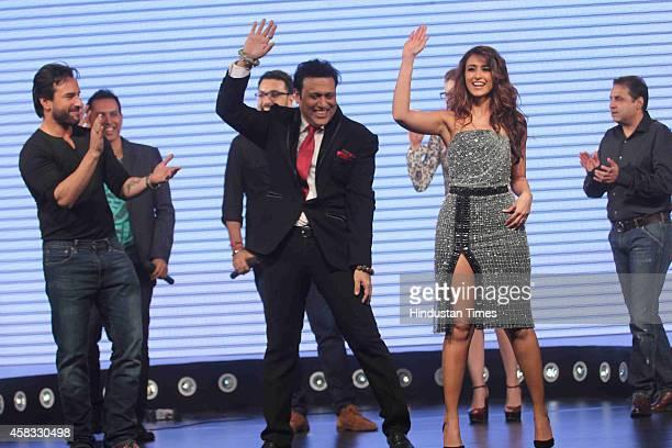 Bollywood actors Saif Ali Khan Govinda and Ileana D'Cruz during the music launch of film Happy Ending on October 29 2014 in Mumbai India