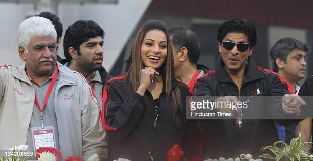 Bollywood actors Shahrukh Khan and Bipasha Basu at the Airtel Delhi Half Marathon on November 27 2011 in New Delhi India