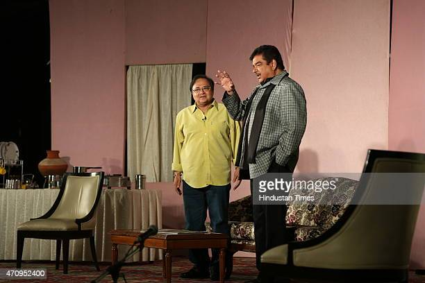 Bollywood actors Shatrughan Sinha and Rakesh Bedi perform during the onstage comic play Pati Patni aur Main on April 19 2015 in New Delhi India