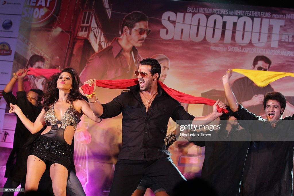 Bollywood actors Sophie Choudhry with John Abraham performing during the promotion of their upcoming film 'Shootout At Wadala' at The Great India Place, shopping mall on April 21, 2013 in Noida, India. It is the sequel to 2007 film Shootout at Lokhandwala, and is based on the book Dongri to Dubai written by Hussain Zaidi. The film features John Abraham, Anil Kapoor, Kangna Ranaut, Tusshar Kapoor and Sonu Sood in lead roles. The film was expected to release on May 1, 2013, but has been postponed to release on May 3, 2013.