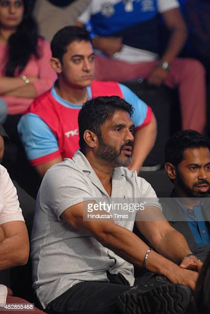Bollywood actors Sunil Shetty and Aamir Khan enjoying Star ProKabaddi league match between Jaipur Pink Panthers and UMumba at NSCI Worli on July 26...