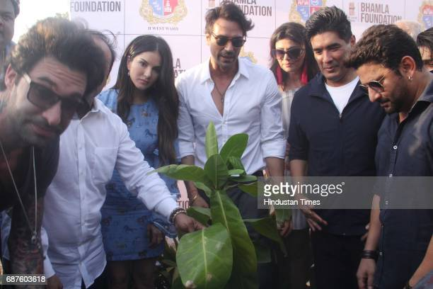 Bollywood actors Sunny Leone Arjun Rampal Pooja Batra designer Manish Malhotra and Arshad Warsi during the grand tree plantation drive where over 500...